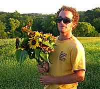 Carden Willis holding flowers at A Place on Earth CSA Farm